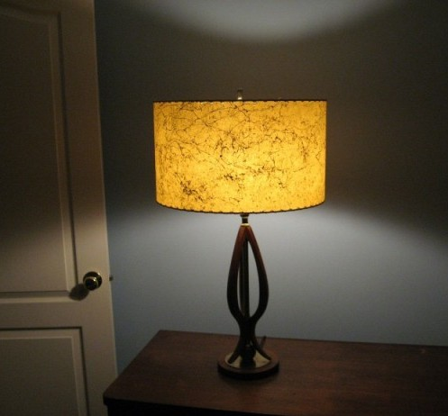 large drum lamp shade casting a shadow on the wall