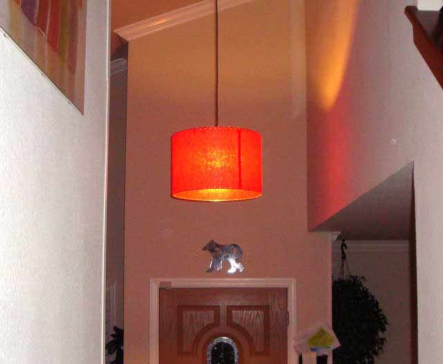 pendant drum lamp hanging in a foyer